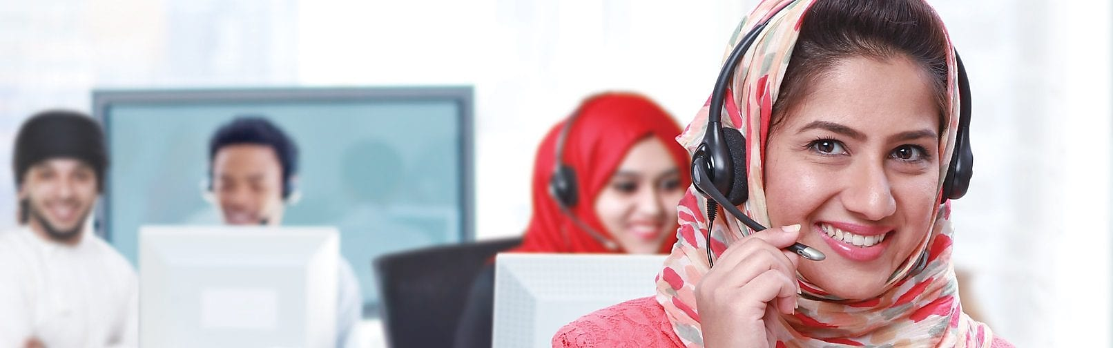 Women wearing headphones and mic answering calls in a call centre,Singapore 2008