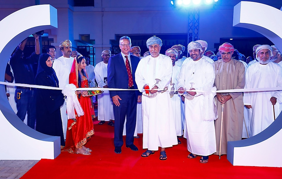 Oman Shell people celebrating anniversary by cutting ribbon