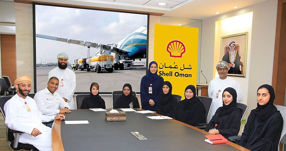 Shell Oman aviation team sitting around a table