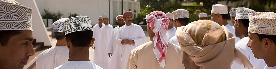 traditionally dressed Omani gathering