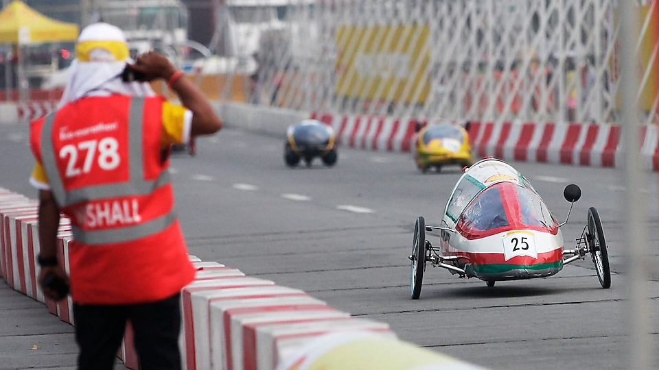 The SQU Eco Wheels, #25, a gasoline prototype vehicle from SQU team at the Sultan Qaboos University in Alkhoudh, Oman, leads other vehicles on the track during the final day of the Shell Eco-marathon Asia, in Manila, Philippines, Sunday, March 6, 2016. (Geloy Concepcion/AP Images for Shell)