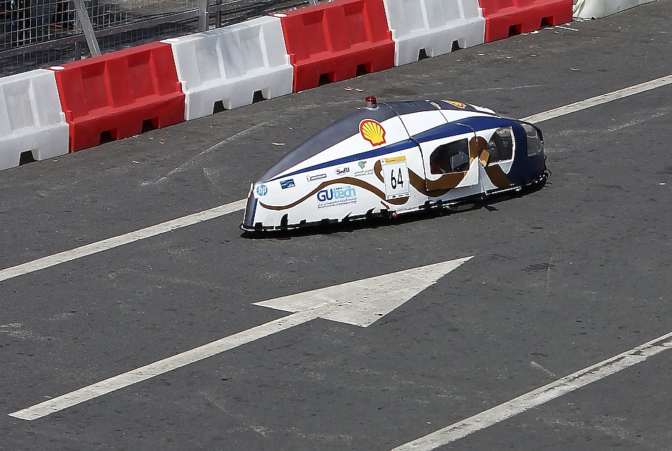 The Mean Machine, #64, Prototype, competing for Team Megalodon from The German University of Technology, Oman runs on the track during day four of the Shell Eco-marathon in Manila, Philippines, Sunday, March 1, 2015.